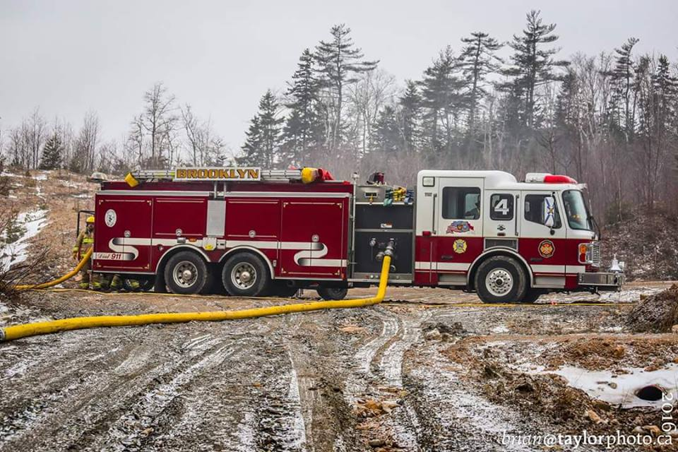 Pumper Tanker 4 on scene of a Dump fire in North Alton. Winter 2016