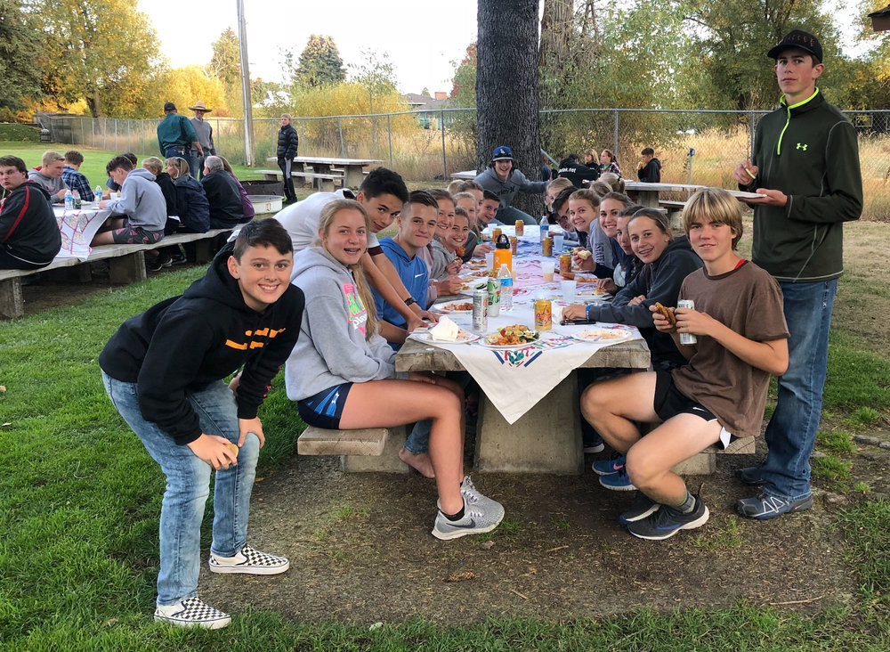 Cross country team dinner with Mountain Beef lasagna! Kyla seated second on right.