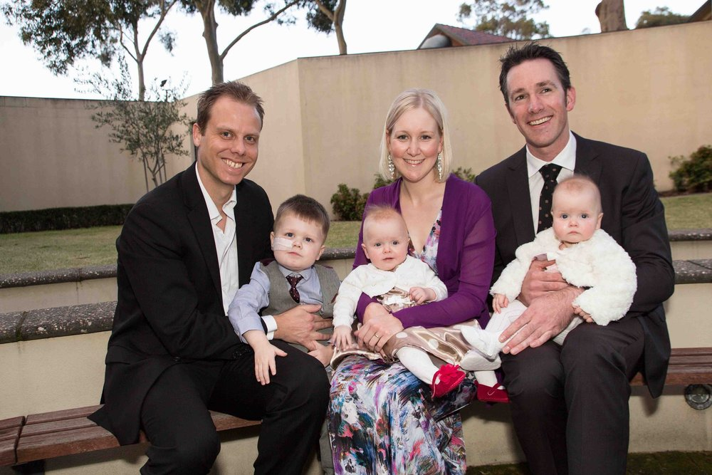 Dr Sasha Rogers (far right) with Ethan and family.
