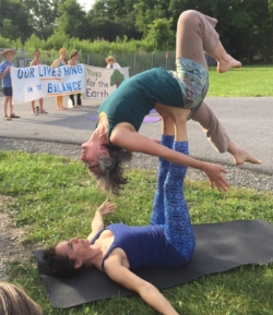 Kelly Morris and Gina Newlin Bend over Backwards and Hang in the Balance at a protest to block gas storage under  Seneca Lake, a drinking source for 100,000 people.