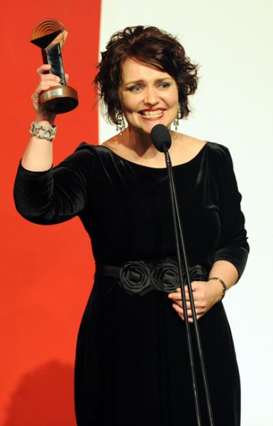 Emma with one of her many Helpmann Awards. Image via the SMH