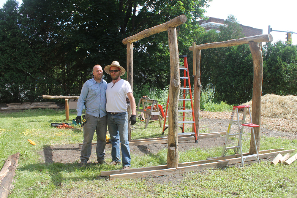 Jay and Matt Lamb of Berkshire Earth Brigade working on a shade structure for vertical beds and a sitting area.