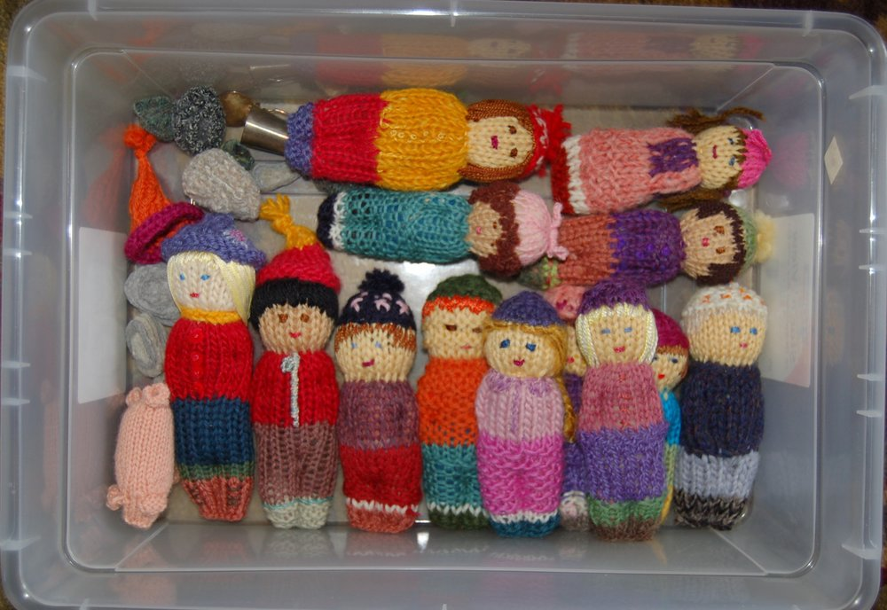 I knit these little people to resemble my daughter's kindergarten class. The big community project that they were to be a part of never came to fruition. So, here they are.