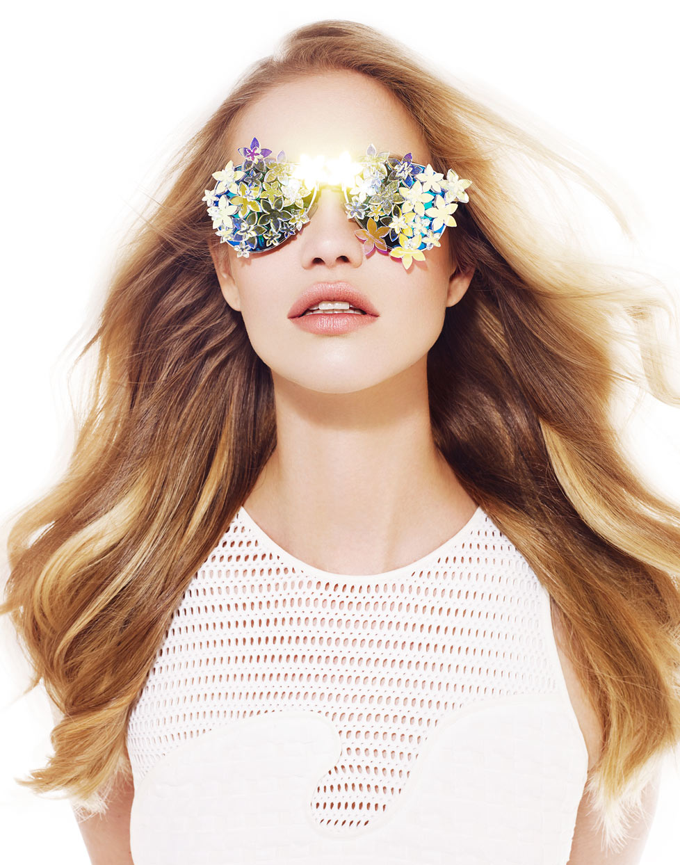 Mark DeLong - Beauty Photographer - Portrait of young woman wearing gold flower covered sunglasses and white mesh sleeveless top