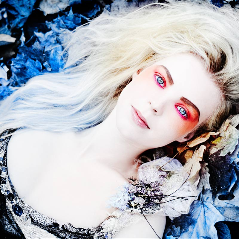 Mark DeLong - Celebrity Photographer - Blonde actress with bright red eye shadow and blue eyes.