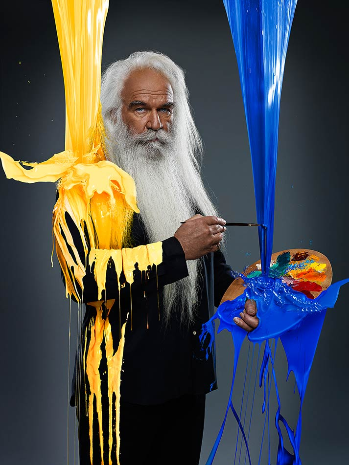 Mark DeLong - Celebrity Photographer - Celebrity with blue and yellow paint falling on him.