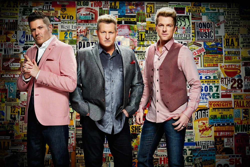 Mark DeLong - Celebrity Photographer - Three male musicians standing in front of a wall of signs.