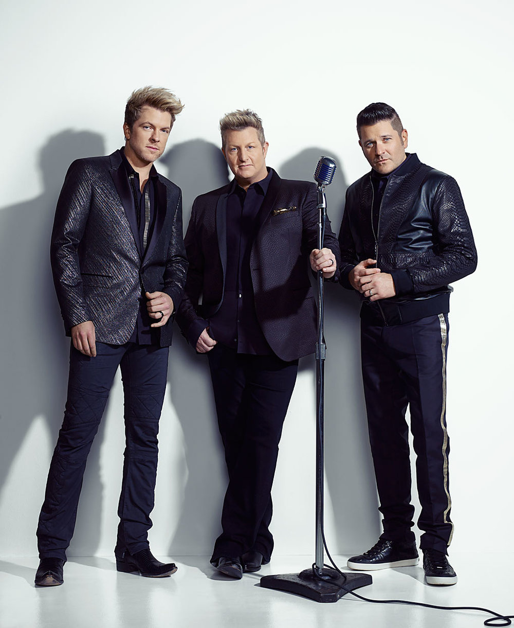 Mark DeLong - Celebrity Photographer - 3 Musicians in black suits standing together.