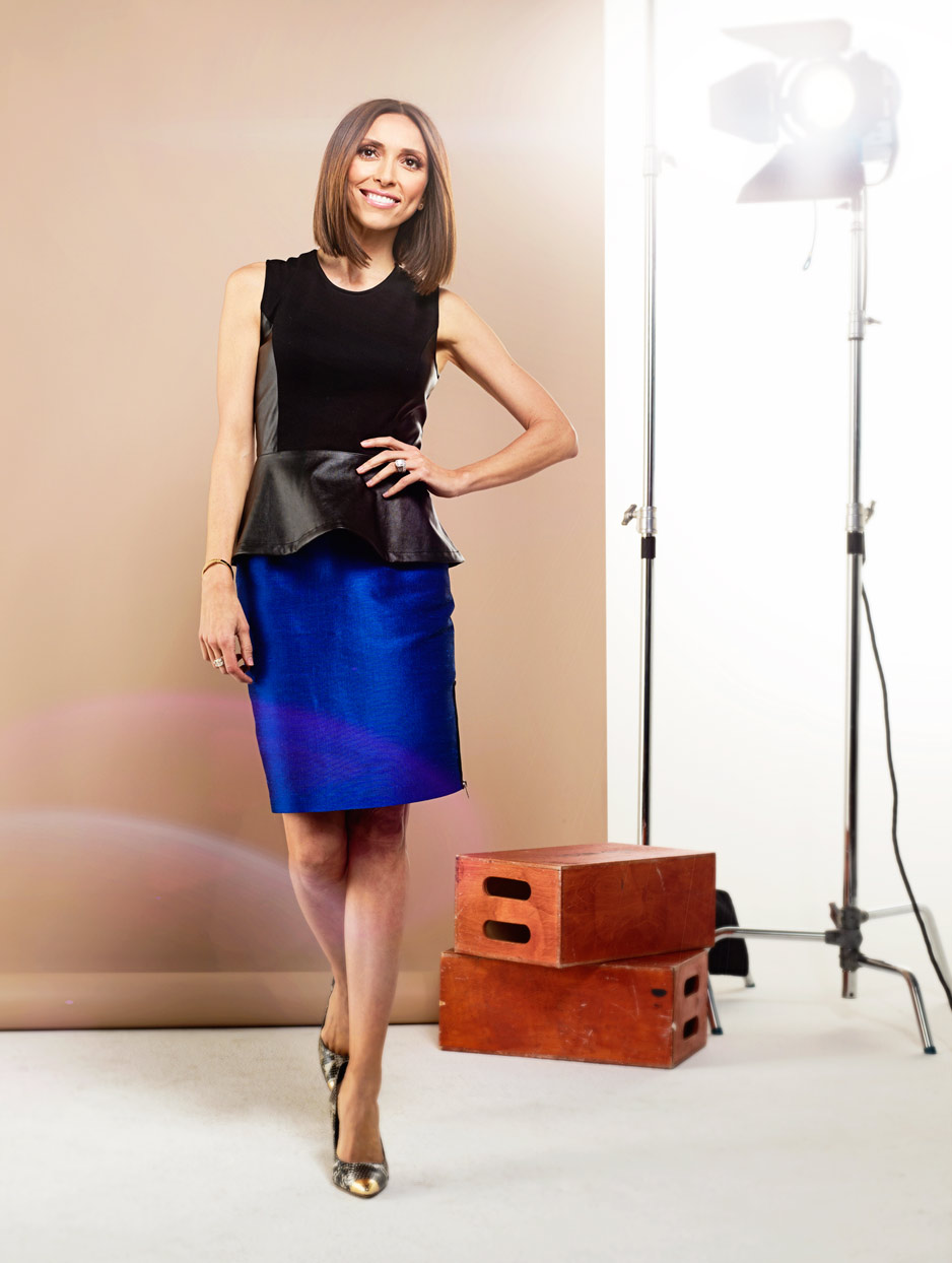 Mark DeLong - Celebrity Photographer - Actress in a blue skirt and black top at a photo shoot.
