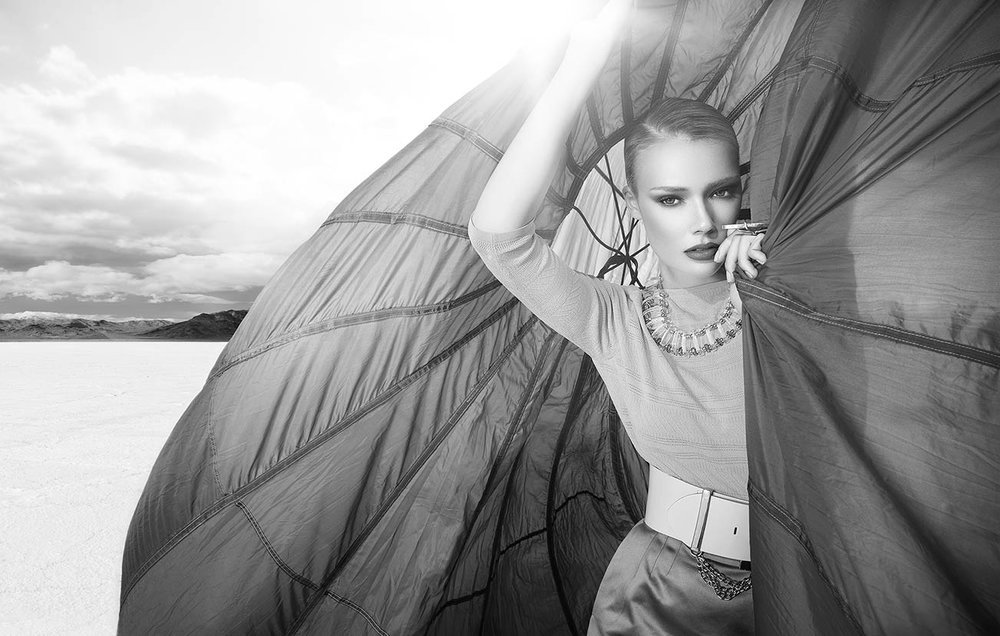 Black and white portrait of a woman with short hair wearing crop top holding a parachute - Mark DeLong: Fashion Gallery