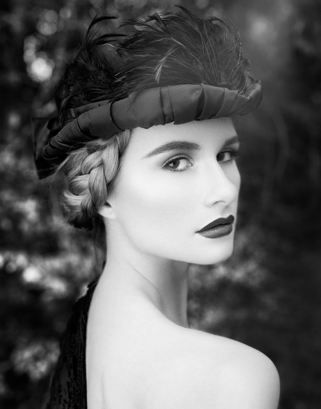 Black and white portrait of woman with braided hair wearing head piece and lipstick looking over her shoulder - Mark DeLong: Fashion Gallery