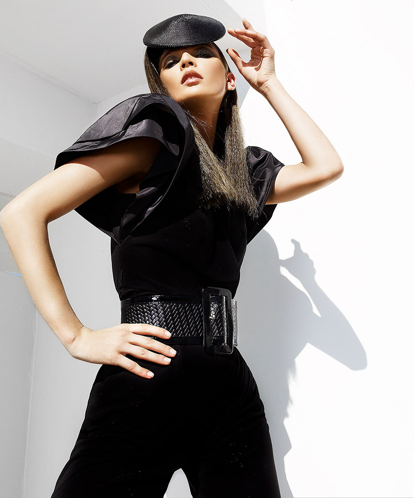 Woman wearing small black hat and large fancy black belt posing - Mark DeLong: Fashion Gallery