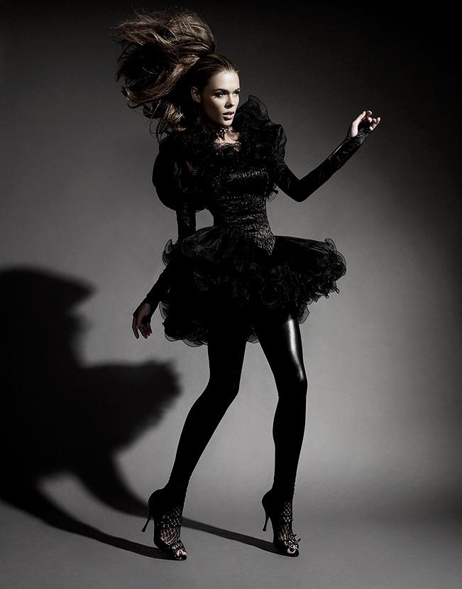Brunette woman wearing all black standing - Mark DeLong: Fashion Gallery