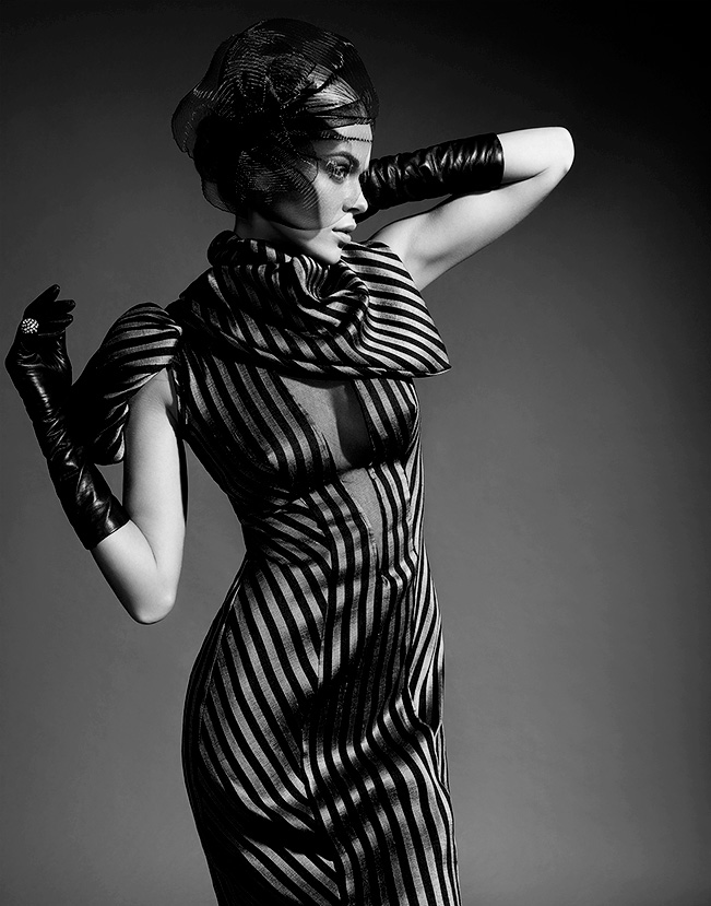 black and white portrait of woman with short hair looking to the side wearing a striped long fitted dress - Mark DeLong: Fashion Gallery