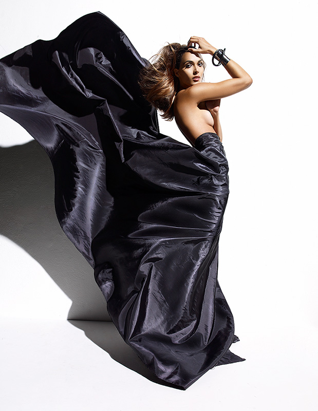 Topless brunette woman wearing long large black elegant dress flowing behind her - Mark DeLong: Fashion Gallery