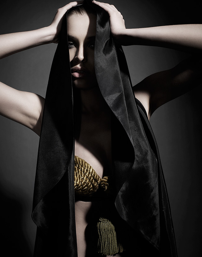 Woman wearing gold minimal top with black silk cloth draped over head - Mark DeLong: Fashion Gallery
