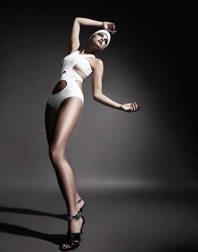 Woman wearing white one piece designer swim suit - Mark DeLong: Fashion Gallery