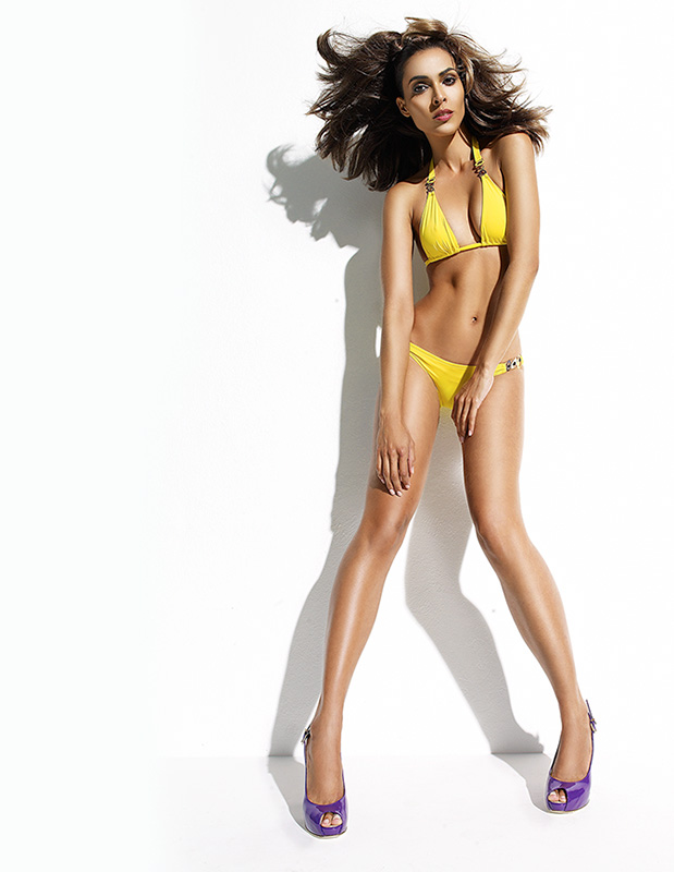 Tan brunette woman with yellow two piece bikini and purple high heels - Mark DeLong: Fashion Gallery
