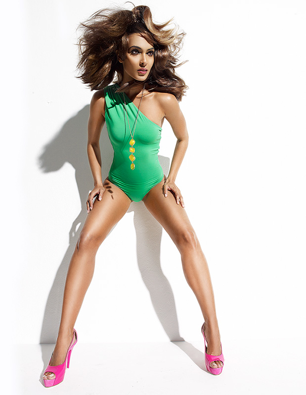 Brunette woman in a green one piece swimsuit and pink heels - Mark DeLong: Fashion Gallery