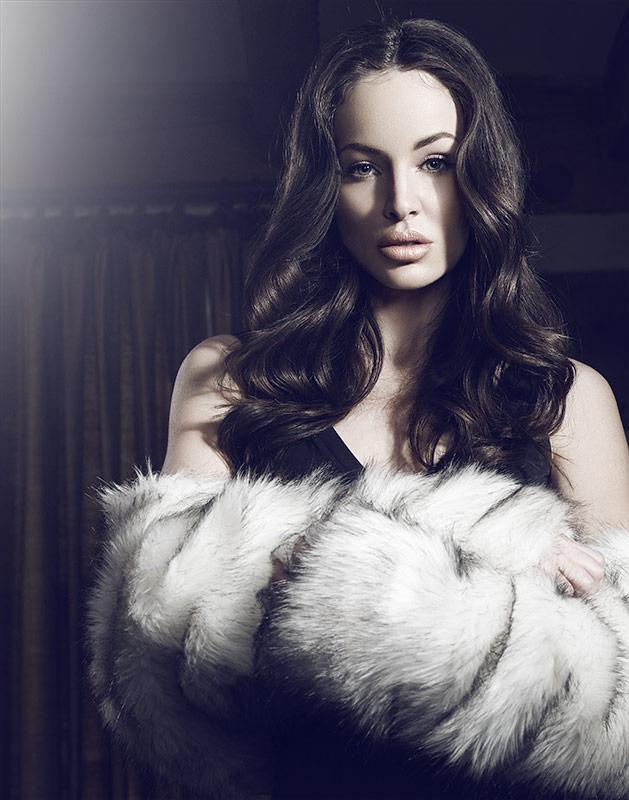 brunette model holding a white fir piece - Mark DeLong: Fashion Gallery