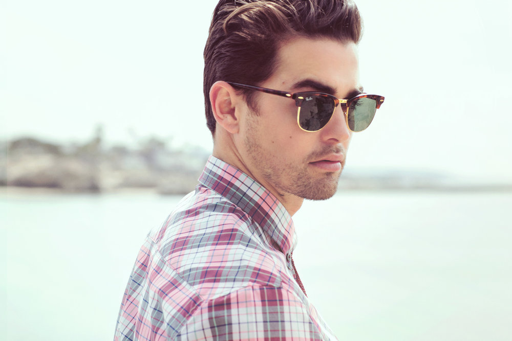Mark DeLong - Lifestyle Photography - Model wearing a gray and red plaid shirt and ray ban sunglasses