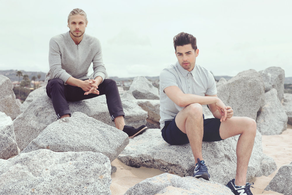 Mark DeLong - Lifestyle Photography - Two men sitting on rocks in the sand