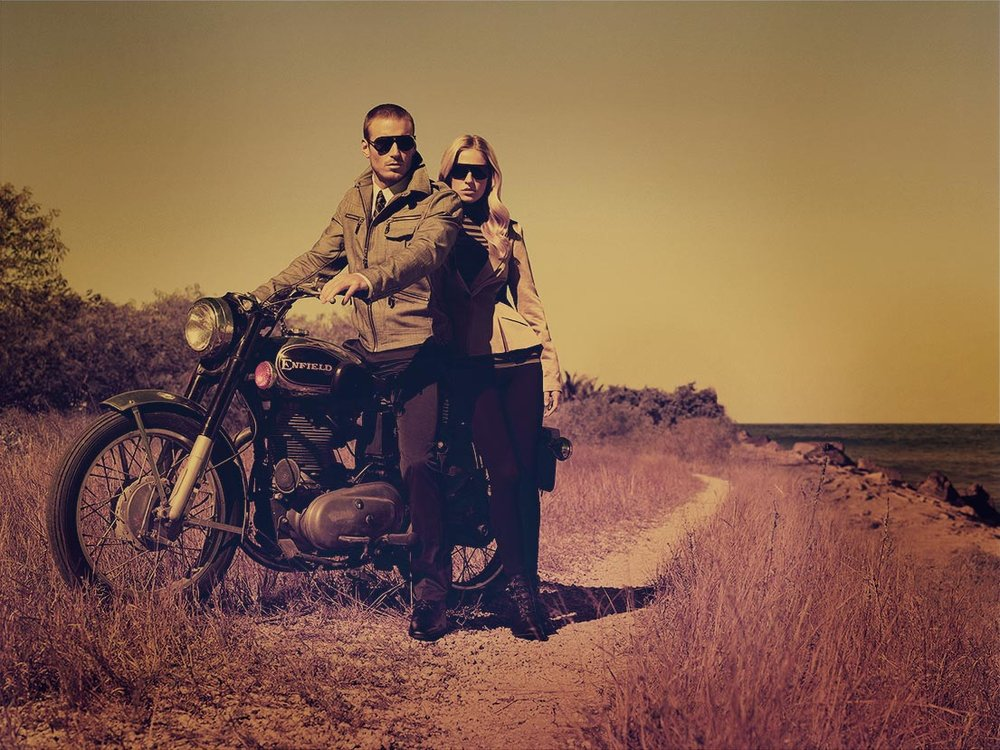 Mark DeLong - Lifestyle Photography - A man and woman parked on the side of the road on a motorcycle wearing sunglasses