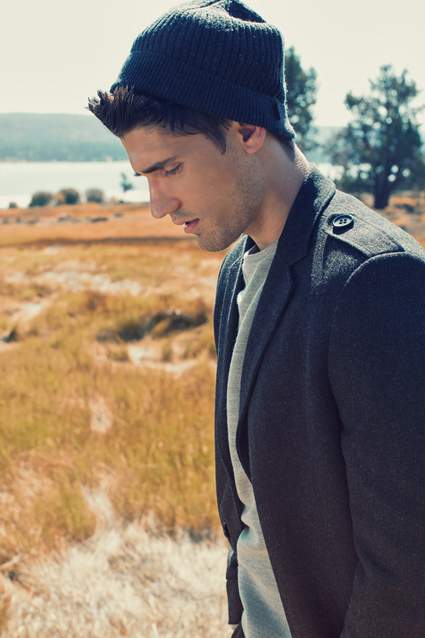 Mark DeLong - Lifestyle Photography - Model wearing a dark gray beanie and gray jacket looking at the ground