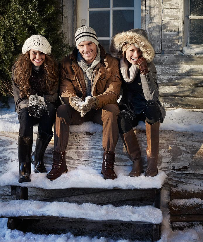 Mark DeLong - Lifestyle Photography - A man and two women sitting on stairs in the snow in winter clothes