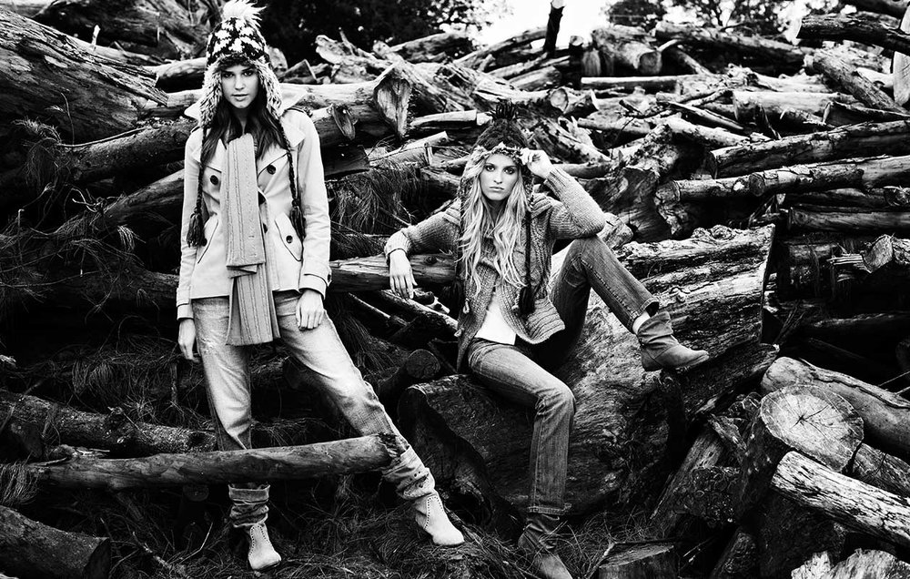 Mark DeLong - Lifestyle Photography - Two models sitting on cut firewood in winter clothes