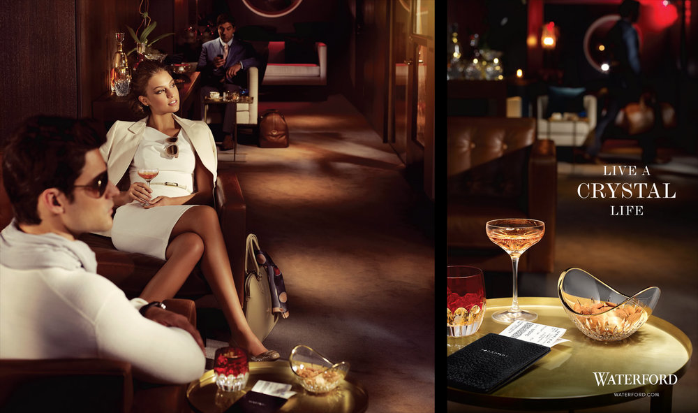 Mark DeLong - Commercial Photography - Couple sits outside with drinks at night.
