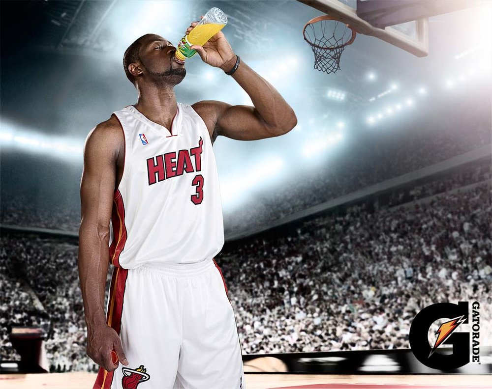 Mark DeLong - Commercial Photography - Miami heat player drinks from a bottle on court.
