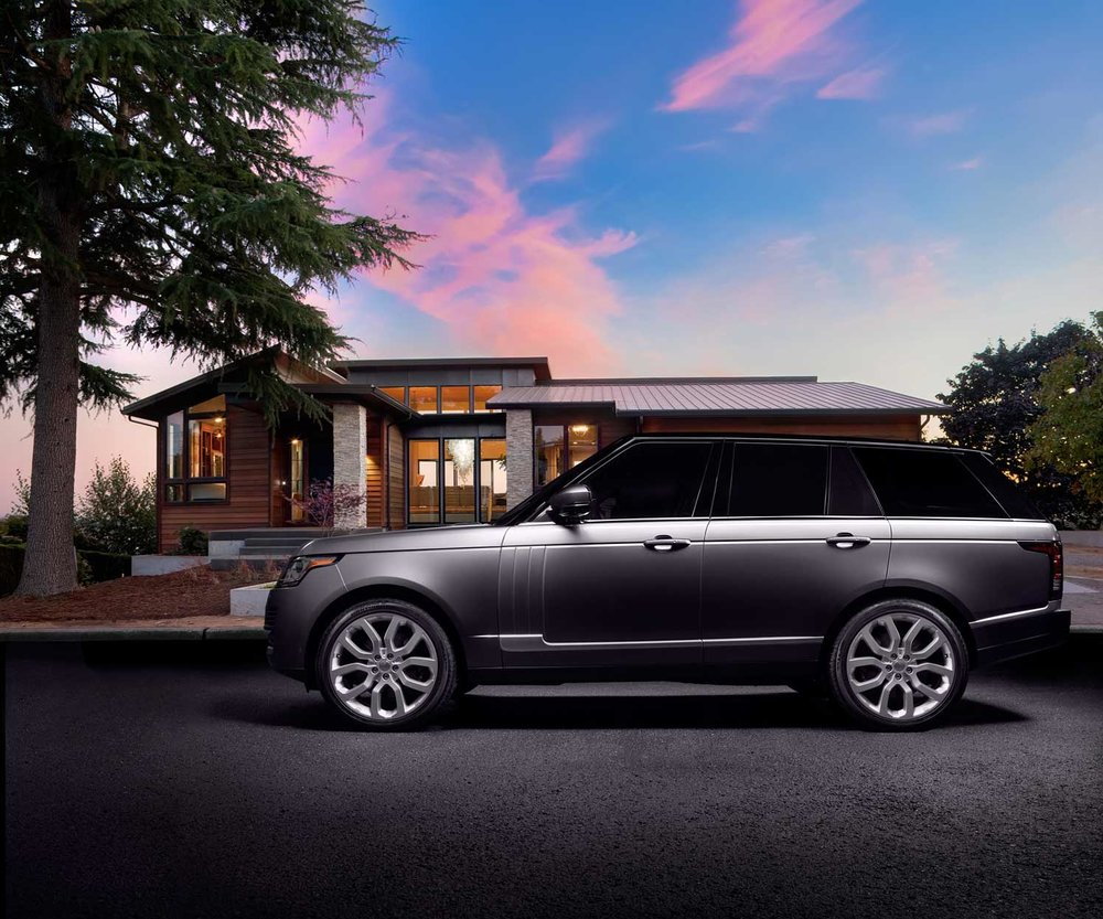 Mark DeLong - Commercial Photography - Silver SUV parked in front of a modern home during sun set.