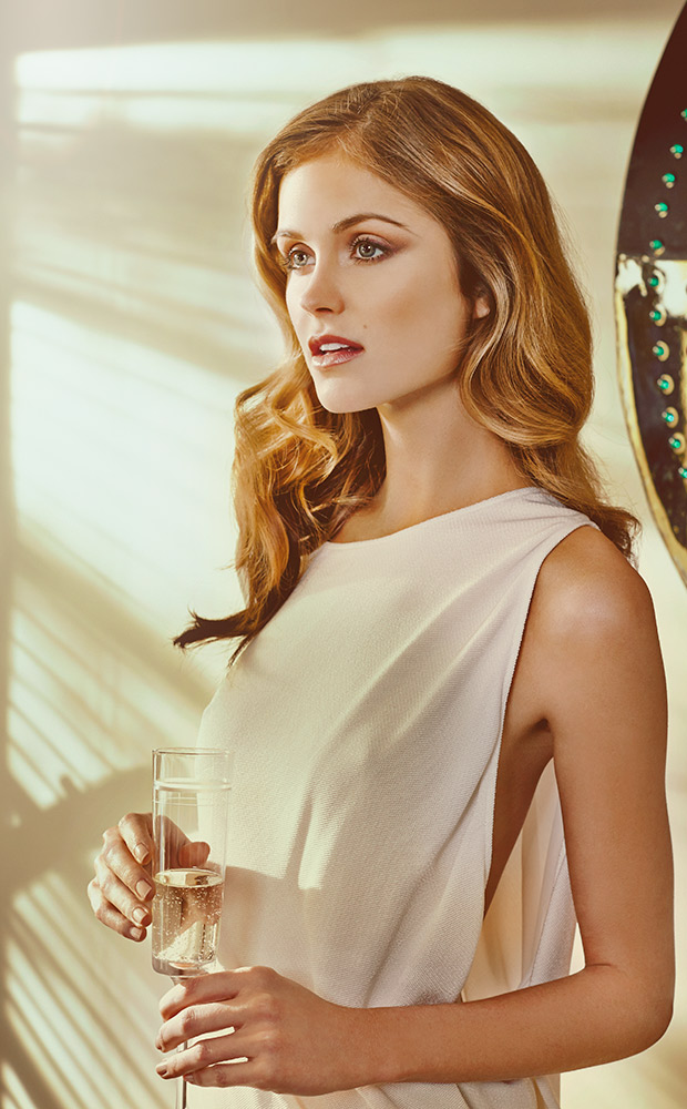 Mark DeLong - Lifestyle Photography - Woman in a white dress holding a glass of champagne