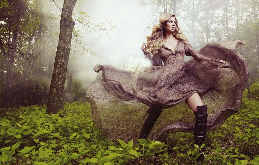 Powerful blond woman wearing faded dark blush pink dress flowing in the meadow with high brown boots - Mark DeLong: Fashion Gallery