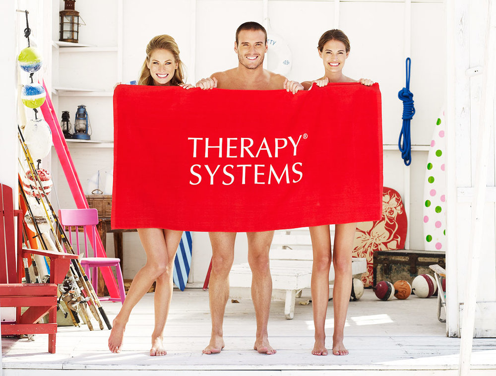 Mark DeLong - Lifestyle Photography - A man and two women hiding behind a red towel