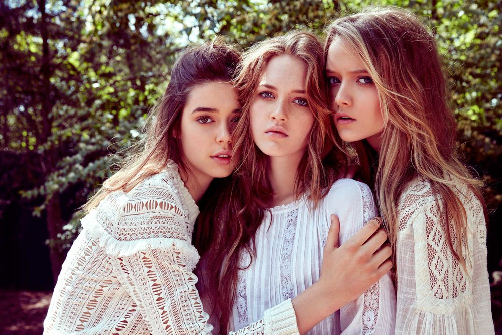 Three girls modeling all wearing white elegant tops - Mark DeLong: Fashion Gallery