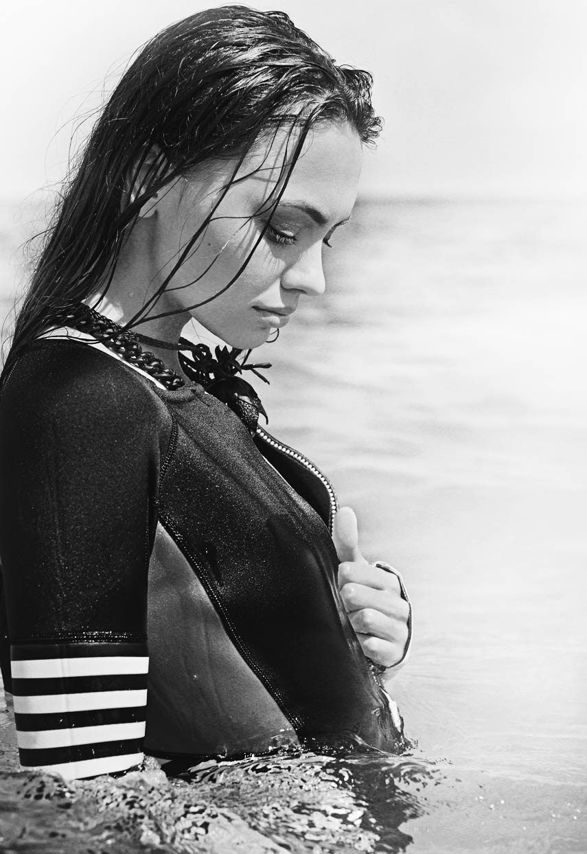 Black and white swimsuit picture of woman looking down into water - Mark DeLong: Fashion Gallery