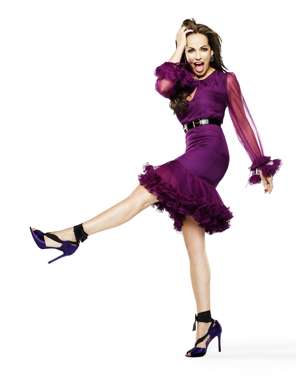 Mark DeLong - Celebrity Photographer - Celebrity in a purple dress and high heels.