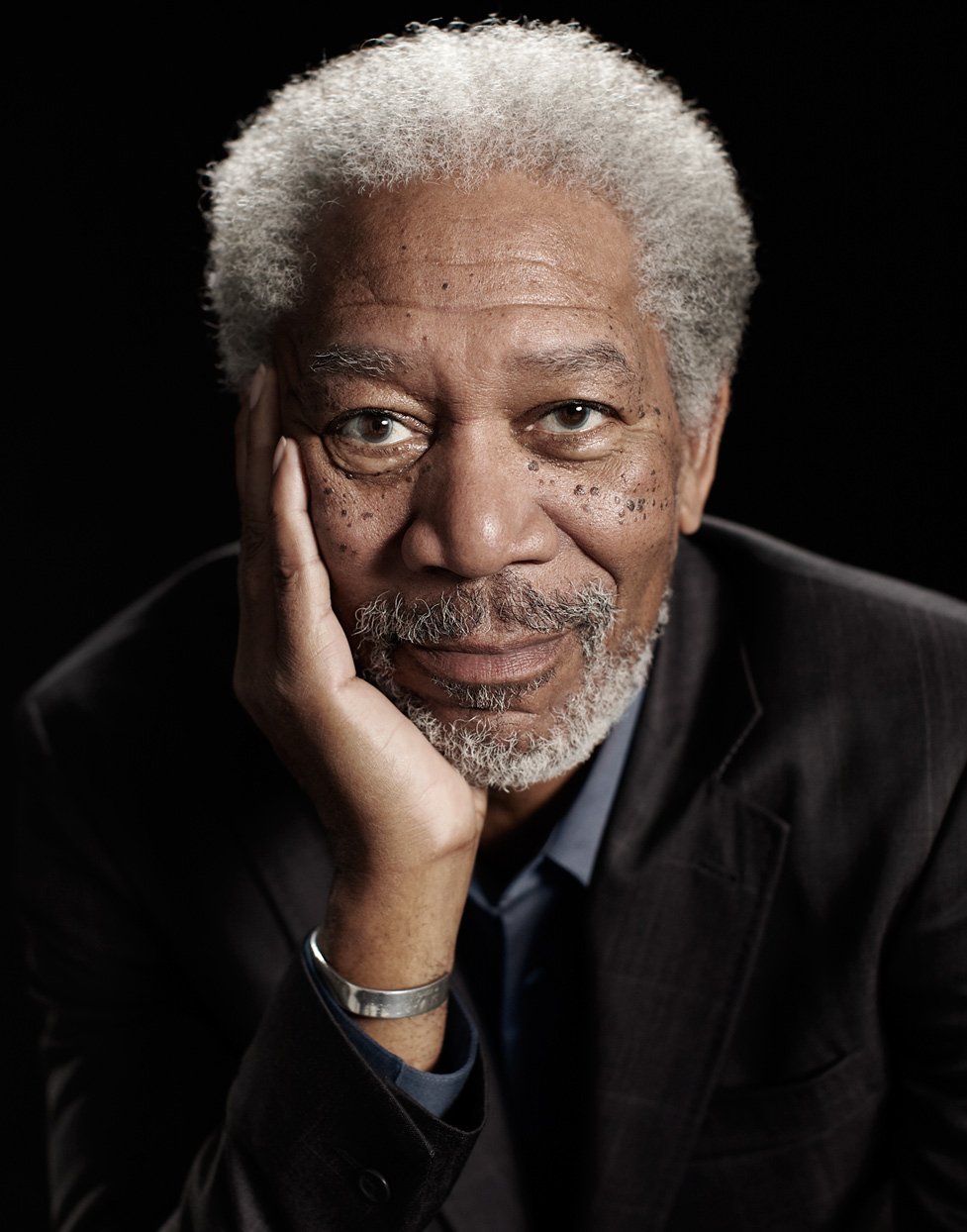 Mark DeLong - Celebrity Photographer - Morgan Freeman profile image with his right hand touching his face.