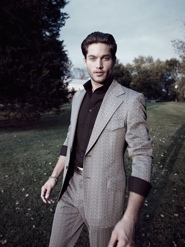 Man with slicked back brown hair wearing gray printed designer suit and black undershirt - Mark DeLong: Fashion Gallery