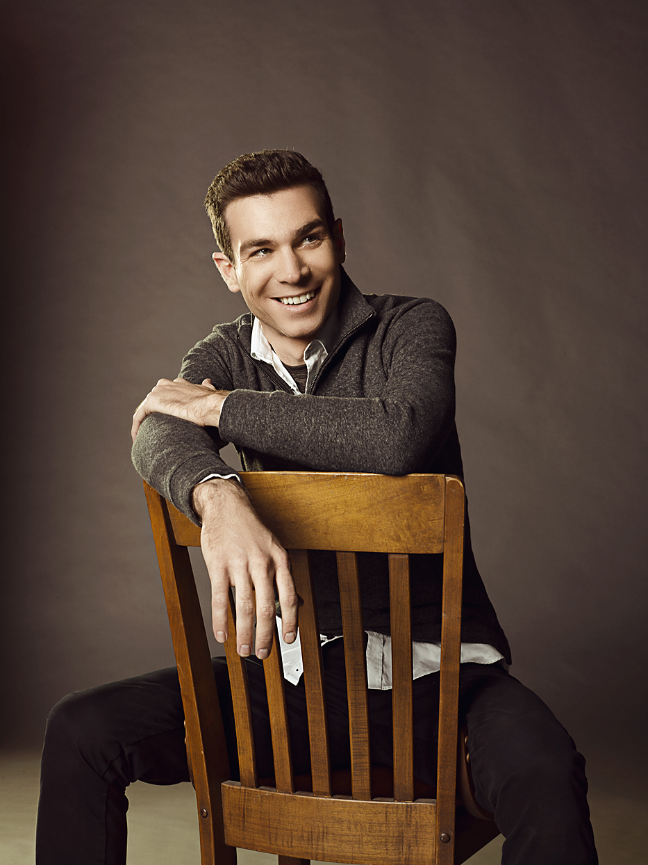 Mark DeLong - Celebrity Photographer - Actor in a grey sweater sitting on a wooden chair.
