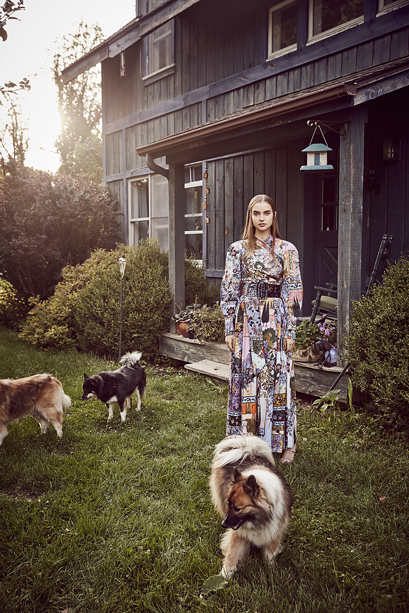 Woman in unique gown standing in front of vintage wooden home with three dogs - Mark DeLong: Fashion Gallery
