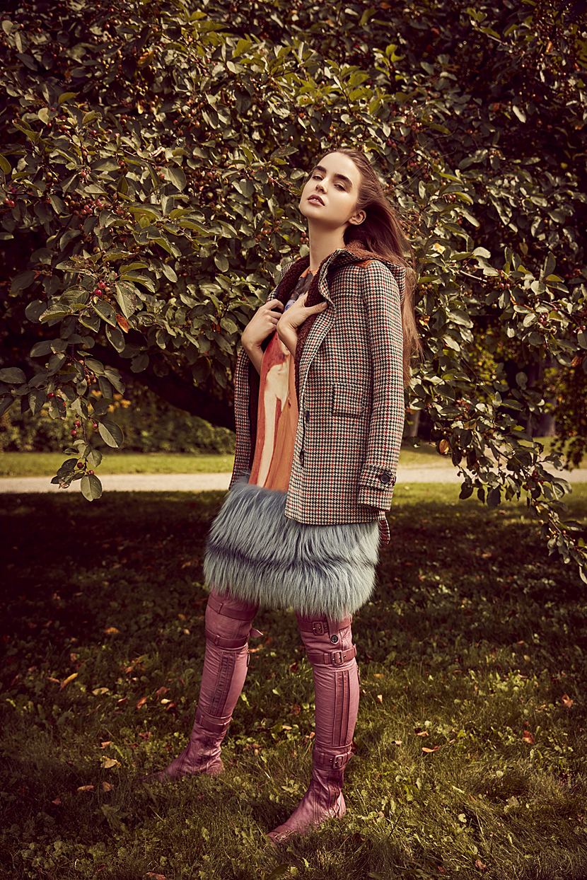 Woman modeling with pink boots and luxury jacket in front of fruit tree - Mark DeLong: Fashion Gallery