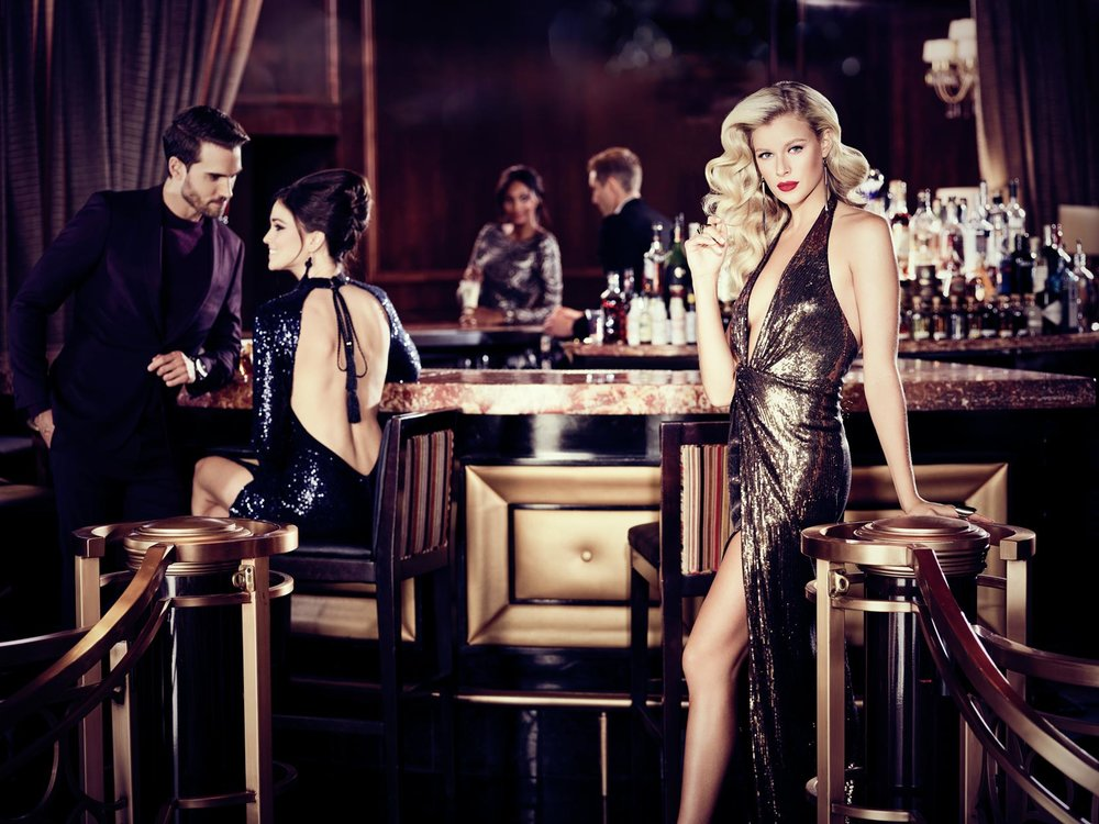 Mark DeLong - Commercial Photography - People sit at a bar with fancy clothes.