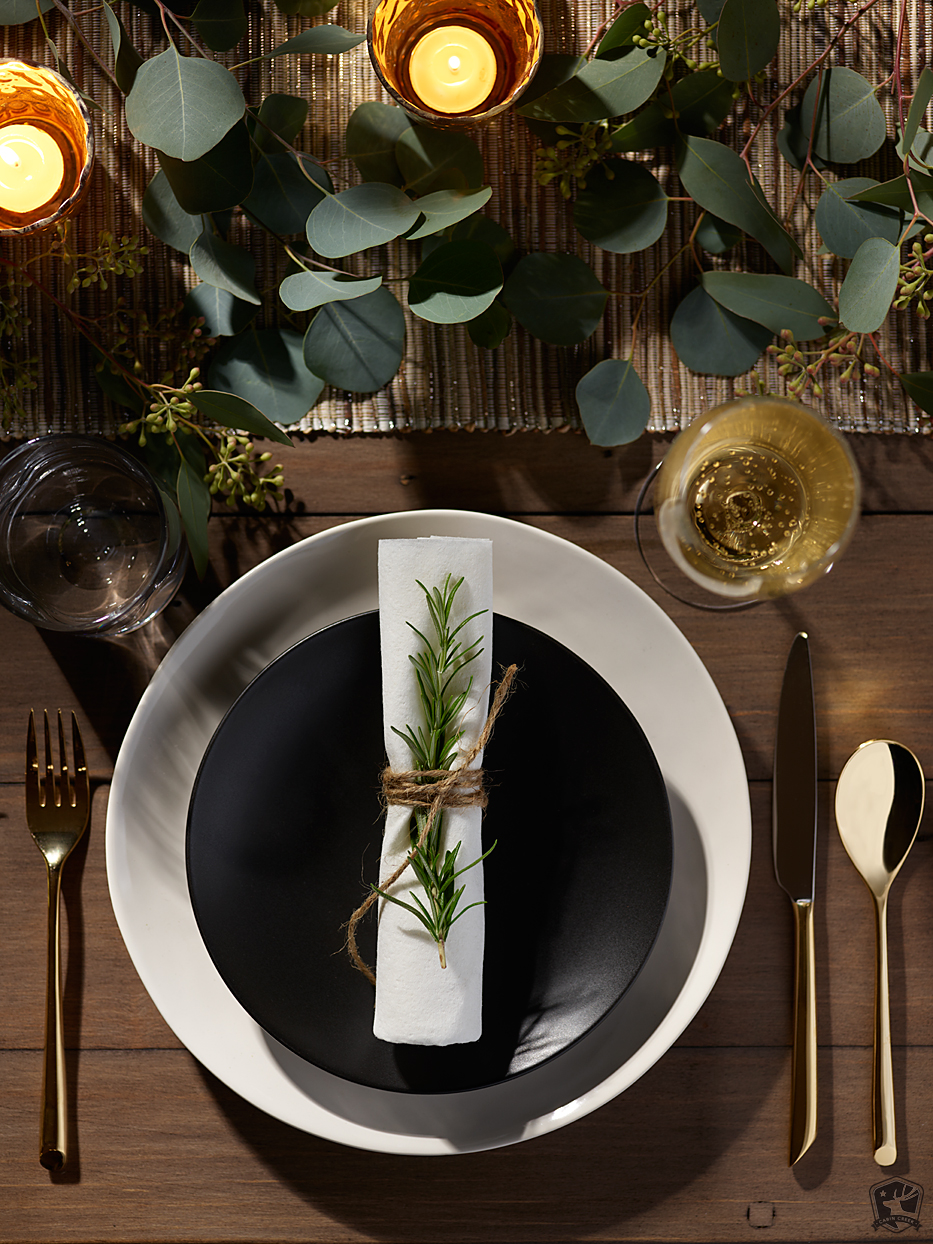 Mark DeLong - Commercial Photography - Fancy place set table with greenery and candles.