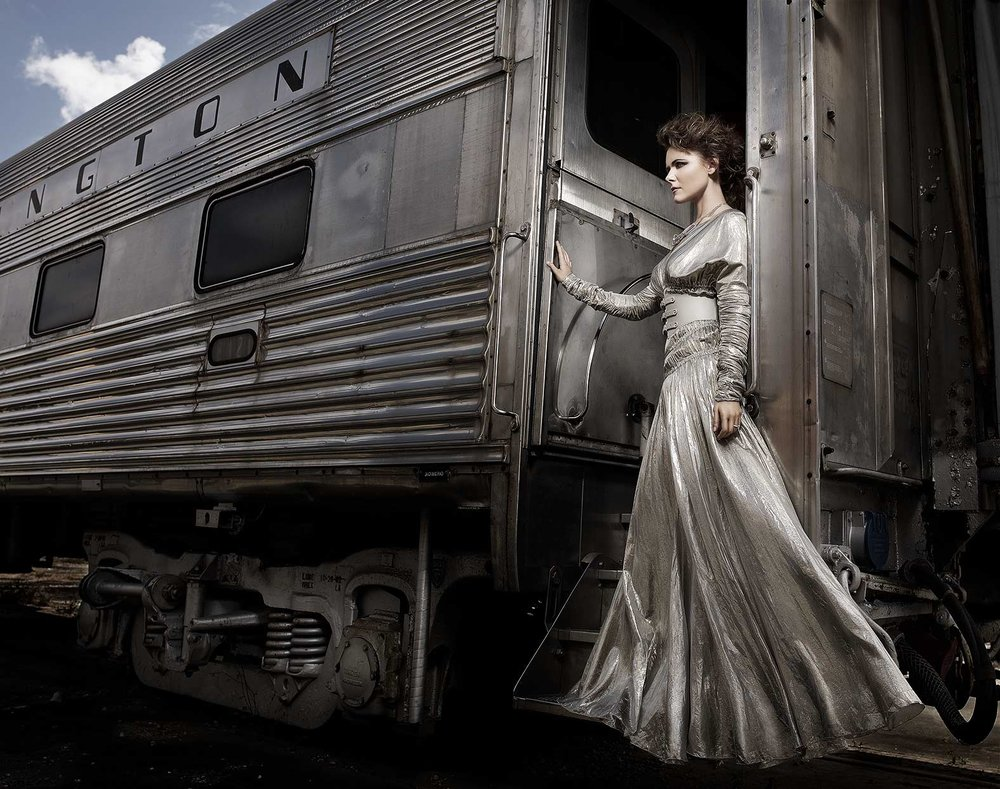 Mark DeLong - Celebrity Photographer - Actress in an old wedding dress standing on a rail car.
