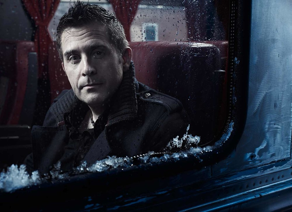 Mark DeLong - Celebrity Photographer - Actor looking into review mirror on a cold day.