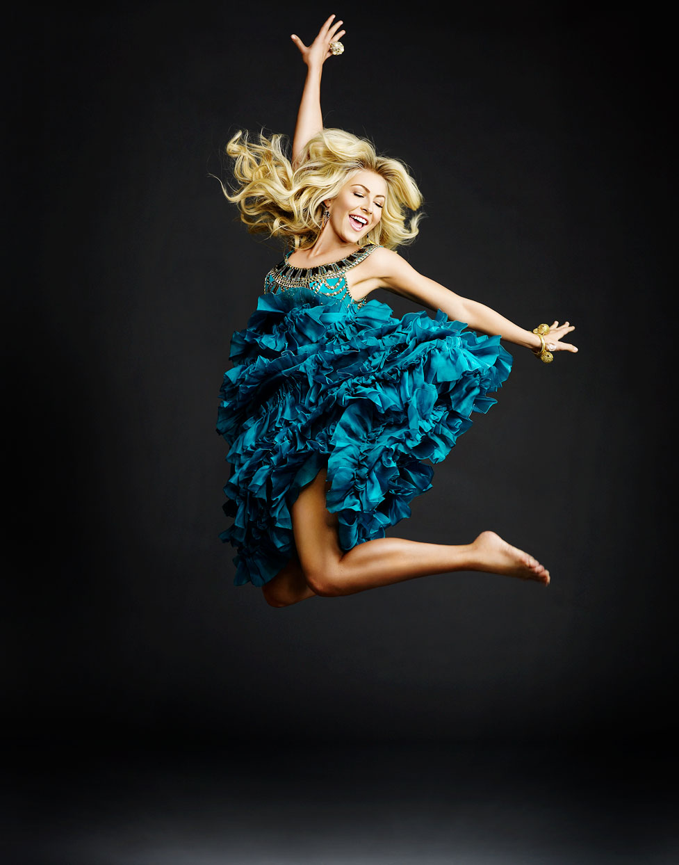 Mark DeLong - Celebrity Photographer - Blonde actress in a blue dress jumping in the air.