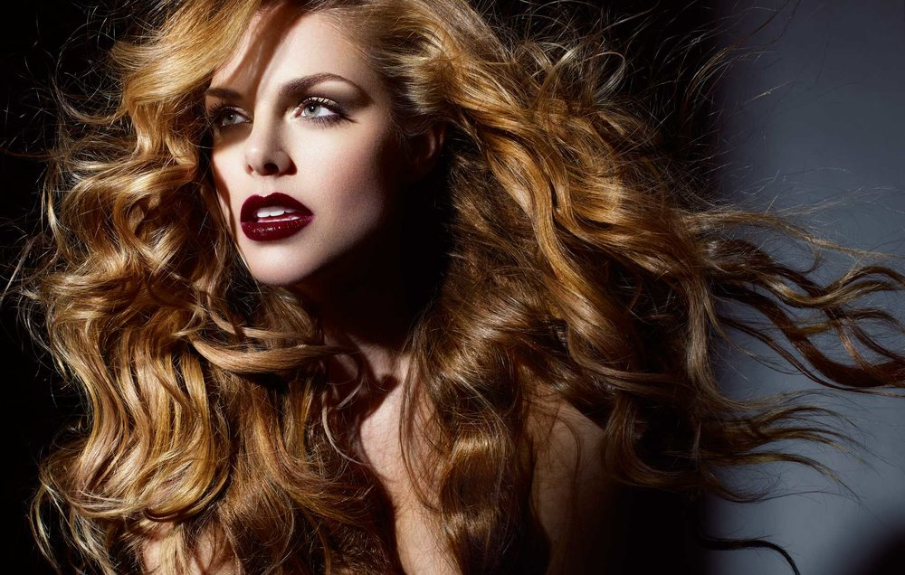 Mark DeLong - Beauty Photographer - Strawberry Blond woman with makeup and dark red lipstick looking into the distance